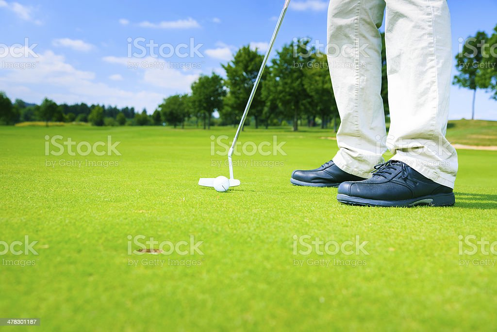 an impossible putting challenge royalty-free stock photo