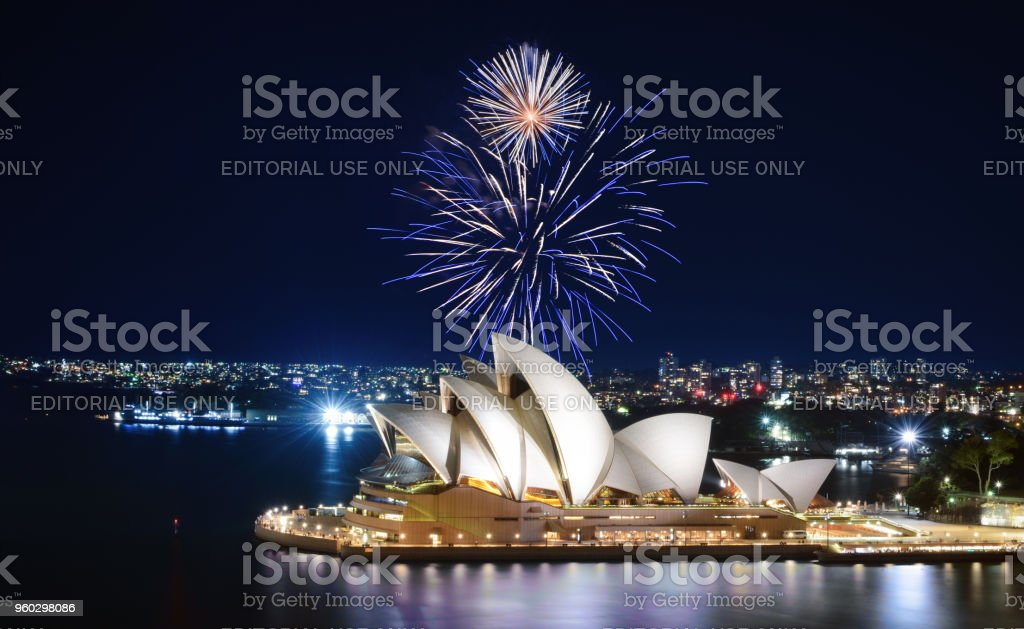 An impressive display of fireworks light up the sky in blue and white over the Sydney Opera House stock photo