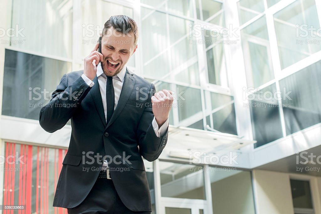 An incredible bargain. Happy businessman celebrates his success. royalty-free stock photo