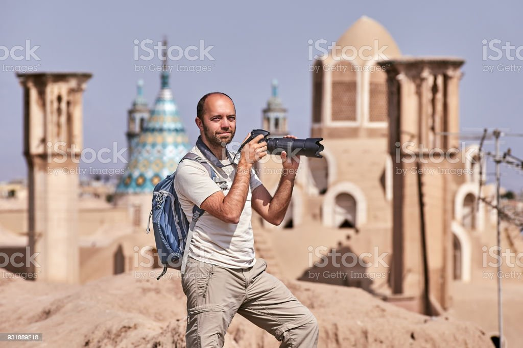 An independent traveler makes a photo, Kashan ancient town, Iran. stock photo