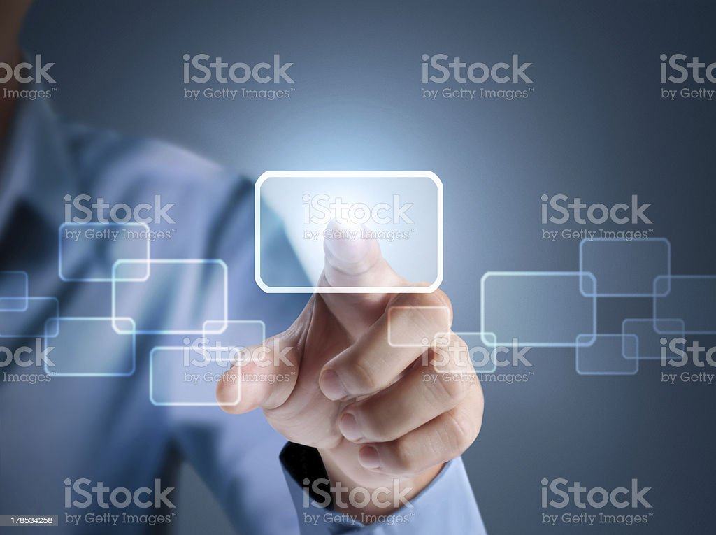 An index finger presses against a touchscreen button stock photo