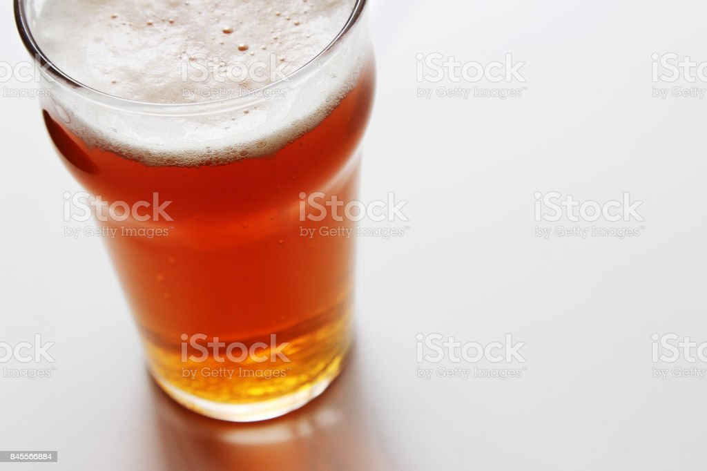 An India Pale Ale craft beer on a white table. stock photo