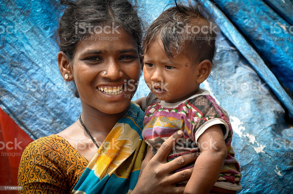 An Indian mother happily holding her baby girl stock photo