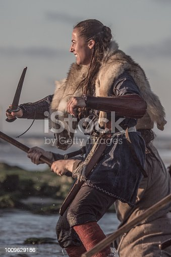 An individual female viking warrior in action on a watery battlefield