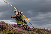 An individual viking warrior archer man on highland moors during a battle