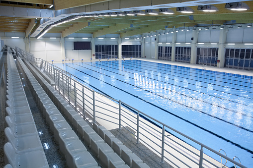 An Indoor Swimming Pool With Empty Spectator Seats Stock Photo Download Image Now Istock