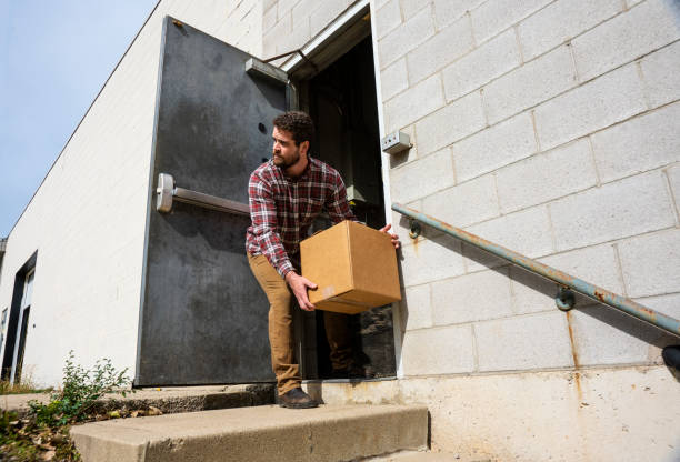 An industrial warehouse employee stealing stock photo