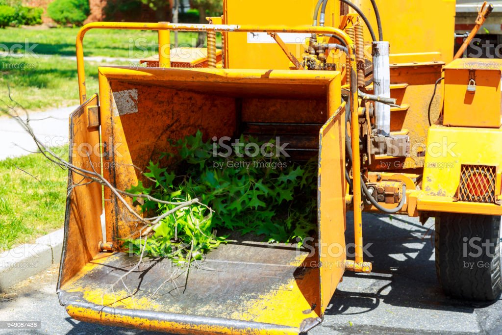 An industrial wood chipper at work stock photo