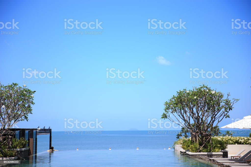 An Infinity Swimming Pool In The Luxury Beach Hotel Stock Photo - Download  Image Now
