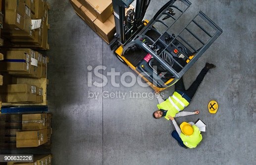 istock An injured worker after an accident in a warehouse. 906632226