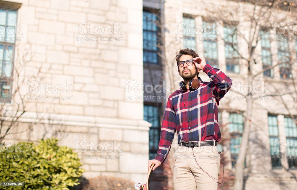 An Intelligent Man in Front of a Nice Building. stock photo