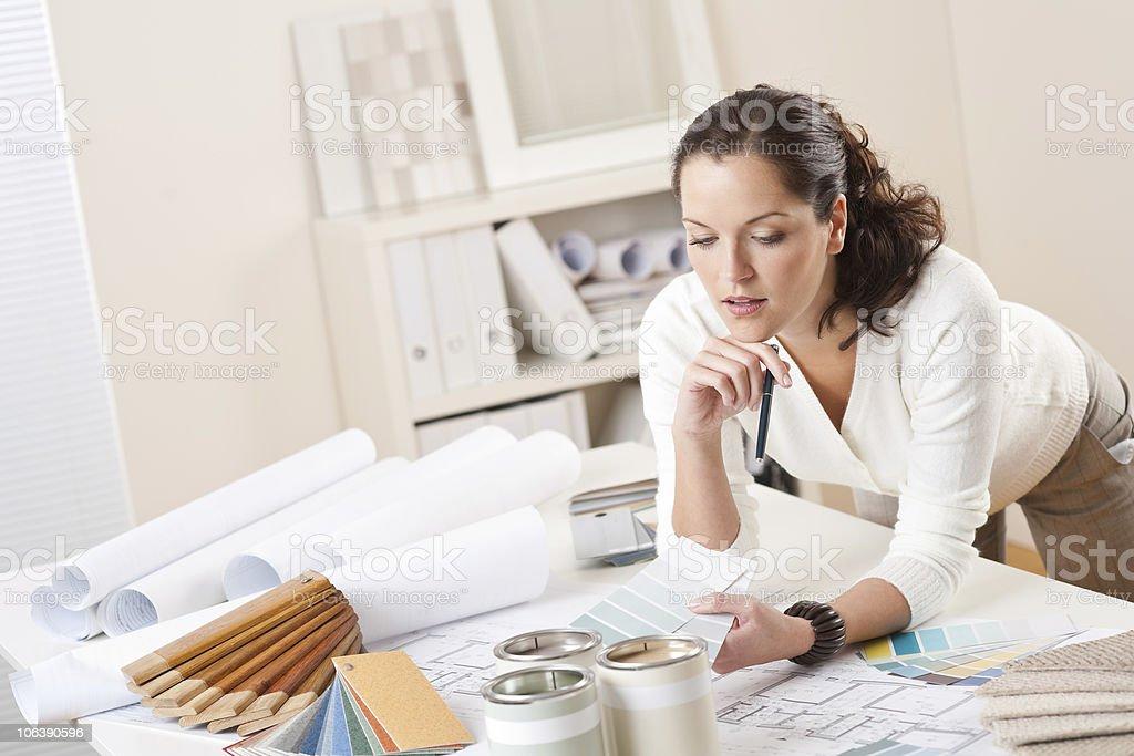 An interior designer working in her office stock photo