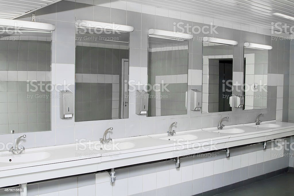 An interior of a private restroom with mirrors stock photo