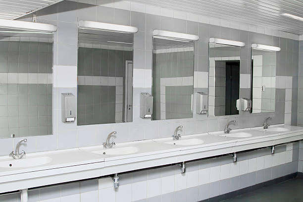 Clean and modern men s public restroom stock photo An interior of a private  restroom with mirrors stock photo. Public Restroom Mirror Pictures  Images and Stock Photos   iStock