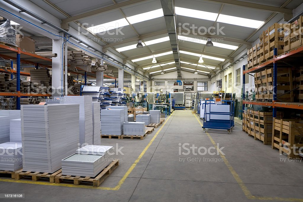An interior view of a large factory warehouse royalty-free stock photo