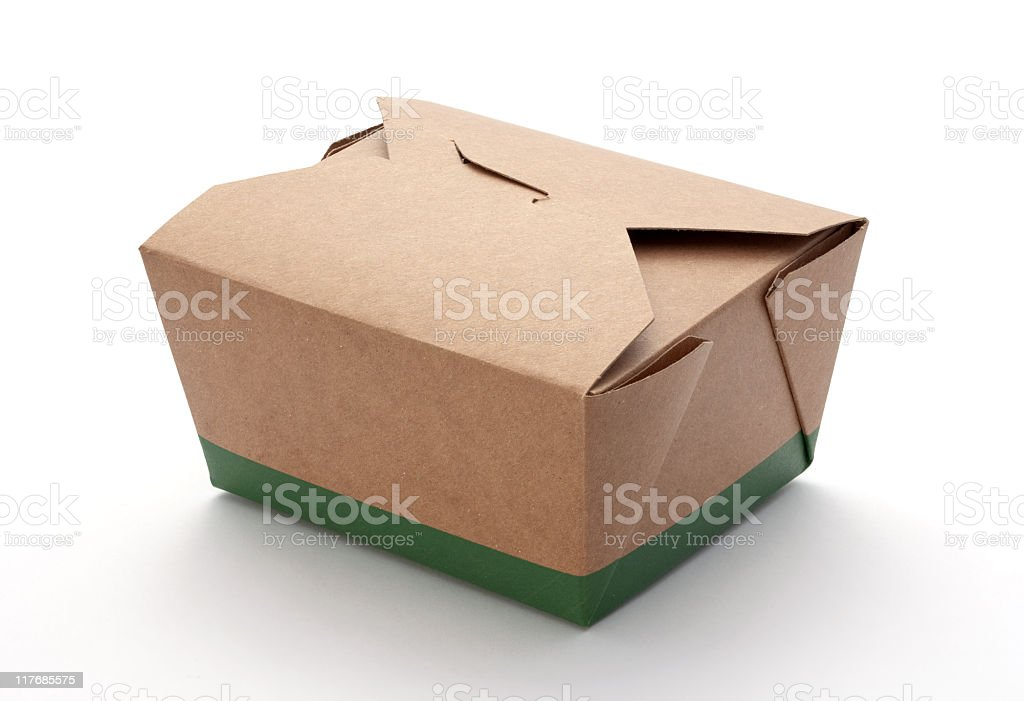 An intricately folded, brown, and green cardboard box stock photo