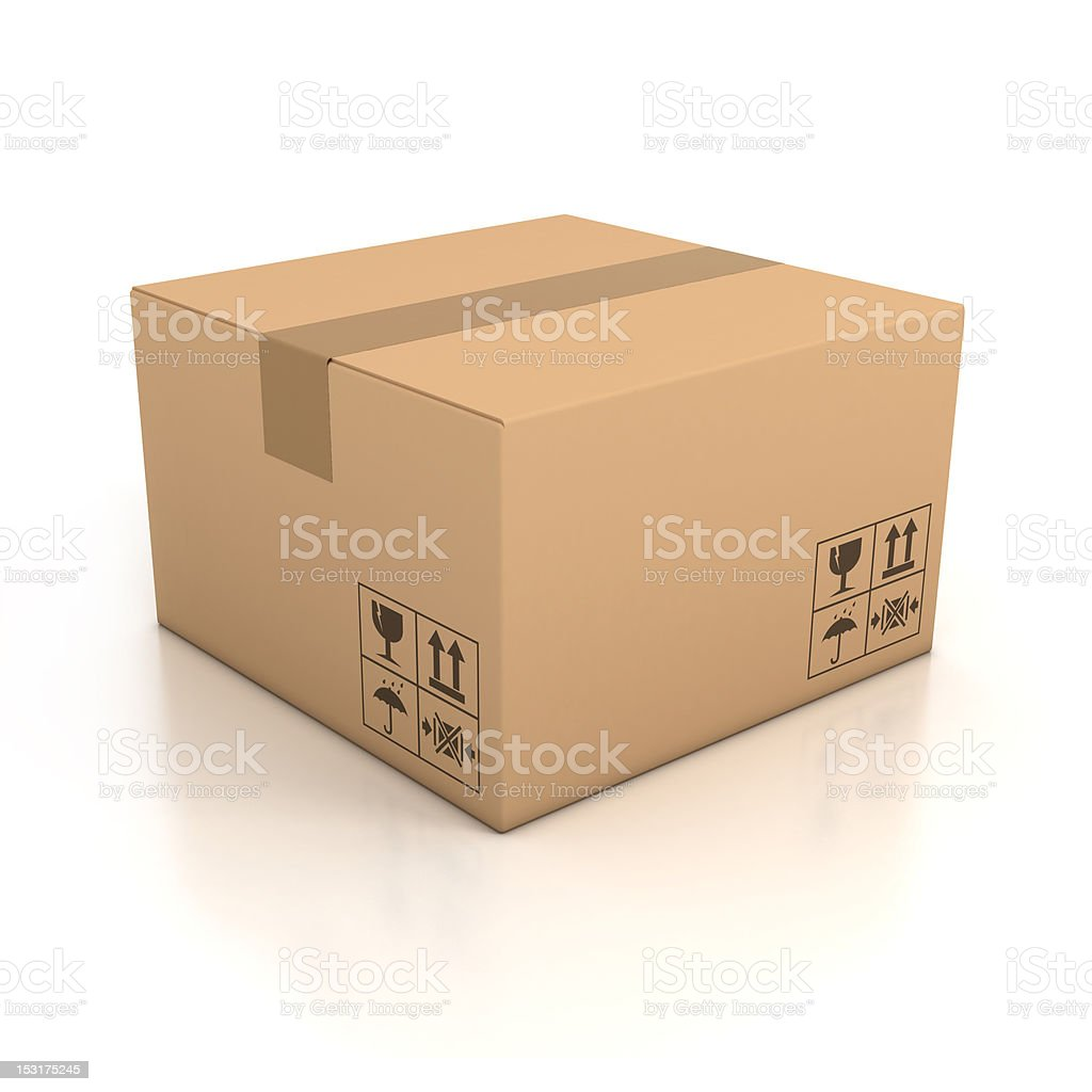 An isolated cardboard box taped up stock photo