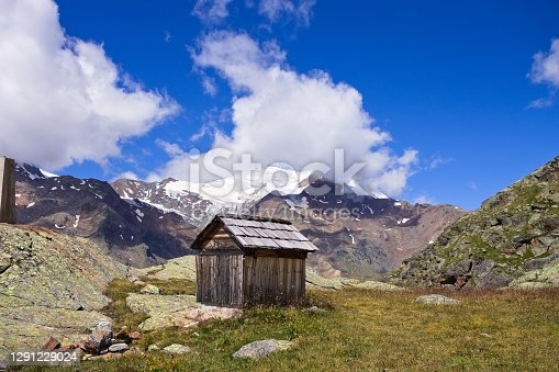 istock An isolated wooden shed with snowy mountains in background in the italian Alps (Trentino, Italy, Europe) 1291229024