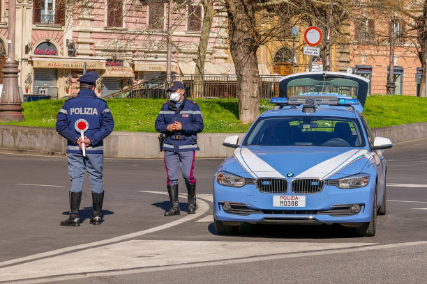 An Italian police patrol control a street near the square of St. Peter's Basilica stock photo