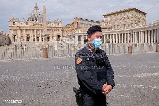 Vatican, Italy, May 18 -- An Italian officer of Carabinieri checks the square of the basilica of St. Peter's, still empty despite the end of the restrictions imposed by the lockdown for the Covid-19 crisis.
