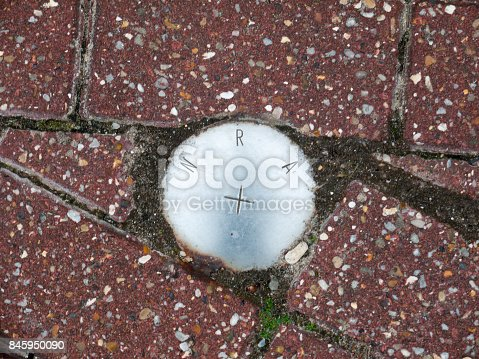 istock an metal circle sign on the ground reading N R A 845950090