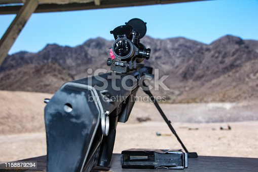 istock An mounted, unloaded, heavy  sniper riflea attached large scope for precision and accuracy, shooting .50 caliber cartridges with huge fire power on a shooting range 1158879294