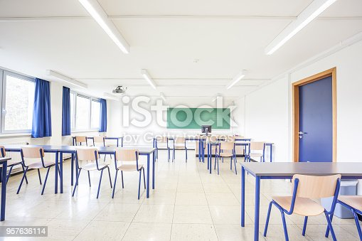 in a building there are several normal classroom with tables and chairs