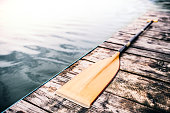 istock An oar on a wooden decking, water in the background. 927919884