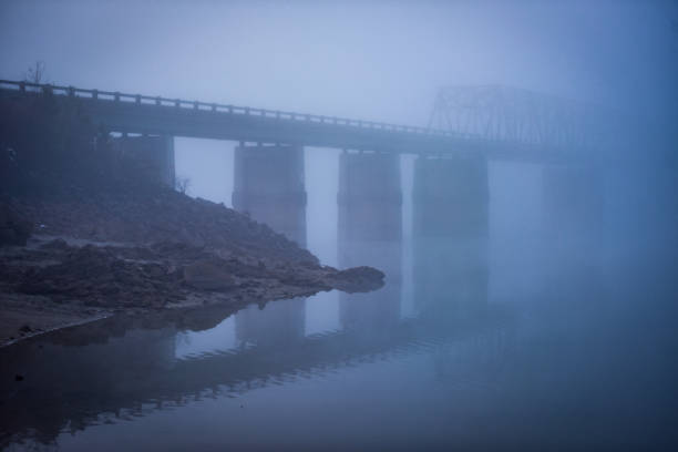 An Occurrence at a Foggy Bridge stock photo