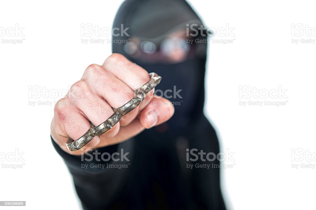 an offender attack with Brass knuckles stock photo