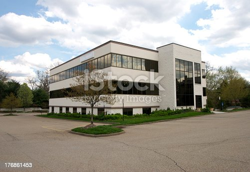 istock An office building with an empty parking lots 176861453