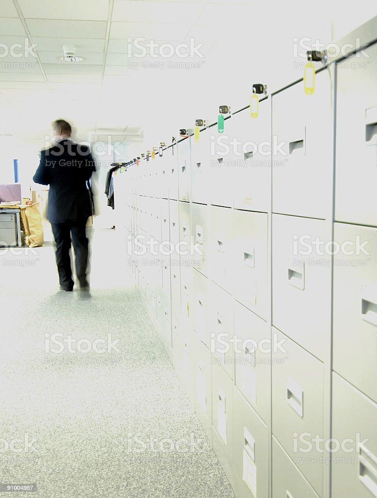 An office scene with keys hanging on a file cabinet stock photo
