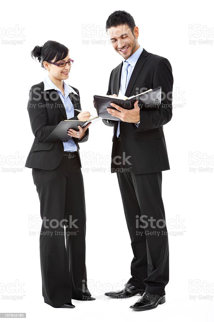 An office staff making an appointment using a planner  stock photo