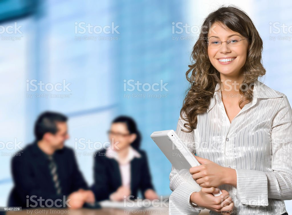 An office worker with glasses carrying her white laptop royalty-free stock photo
