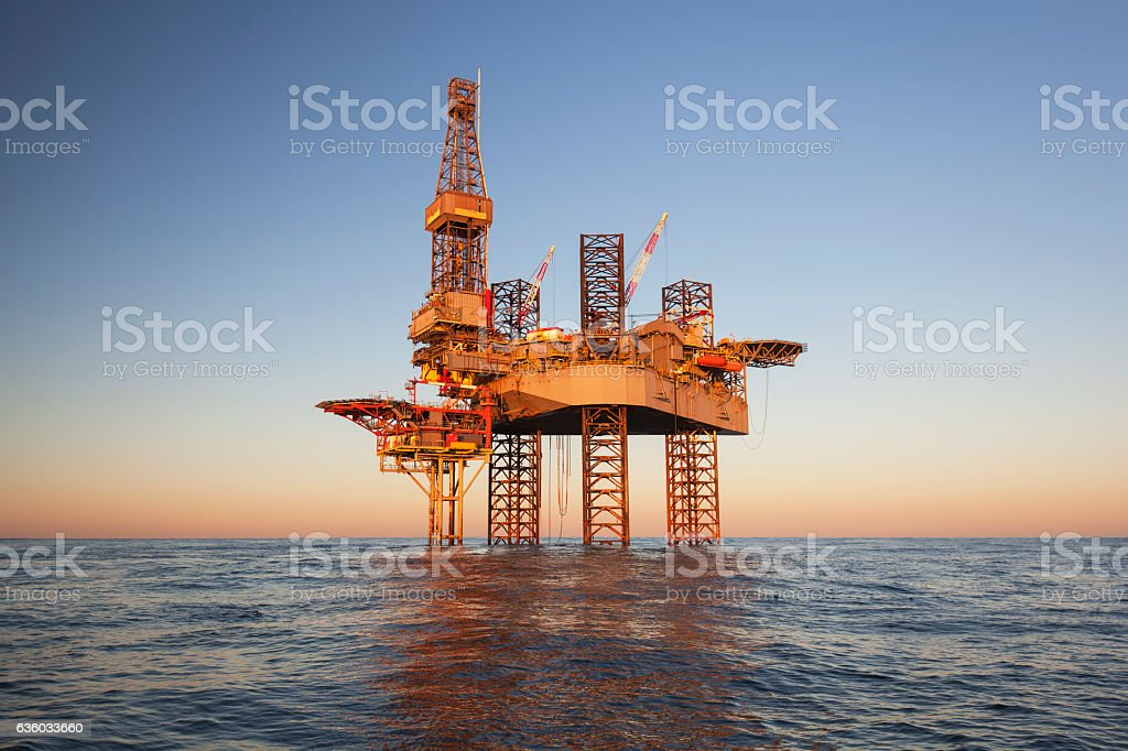 An offshore oil drilling rig stock photo