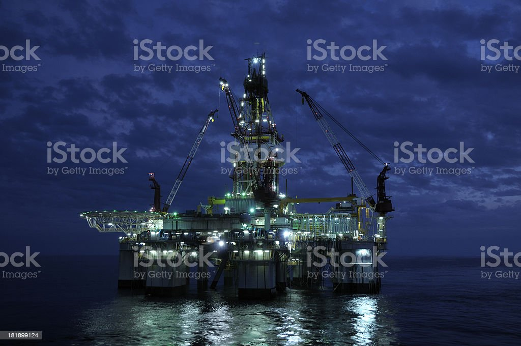 An offshore oil rig shot just before twilight stock photo