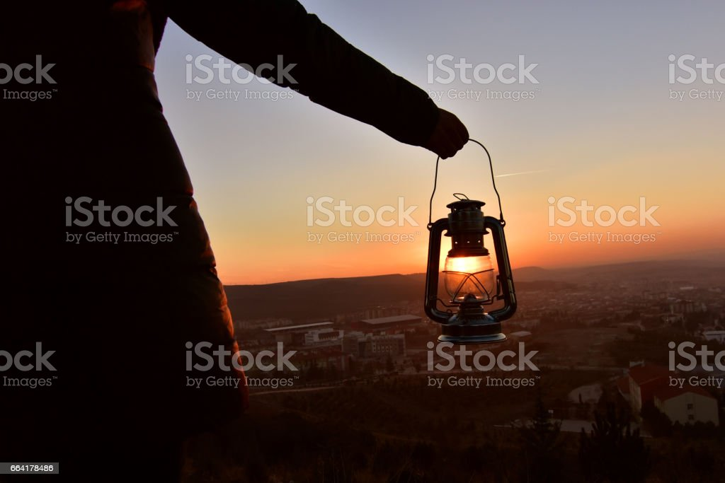 an oil lamp at the sundown landscape stock photo