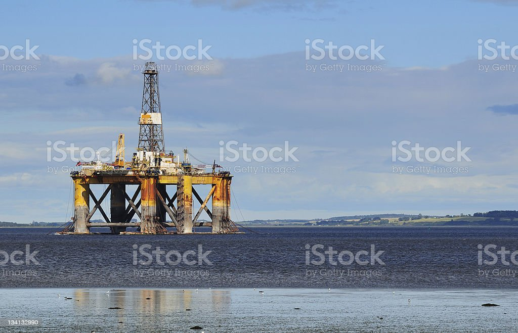 An oil platform in the middle of the ocean royalty-free stock photo