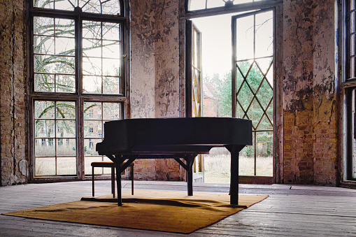 An old abandoned piano in the leftovers of the former sanatorium in Oranienburg, Germany