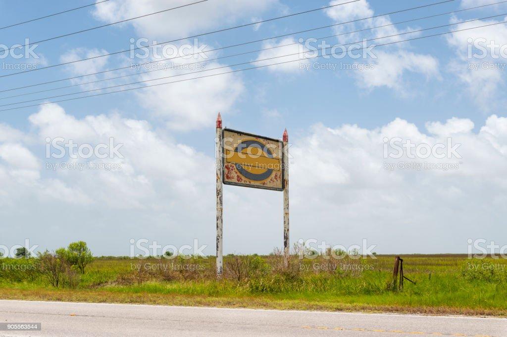 An old and rusty billboard along a roud near Lake Charles, Louisiana stock photo