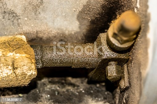 istock an old and rusty leaking pipe of air conditioning unite fixed into AC heavy duty compressor 1138355617