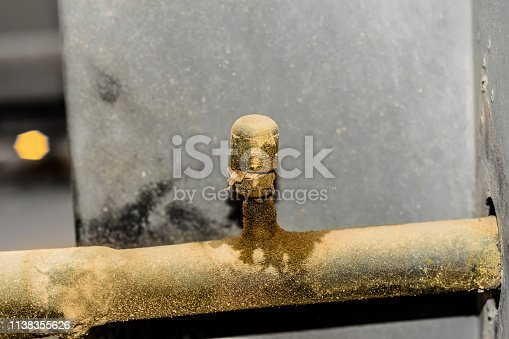istock an old and rusty leaking pipe of air conditioning unite fixed into AC heavy duty compressor 1138355626