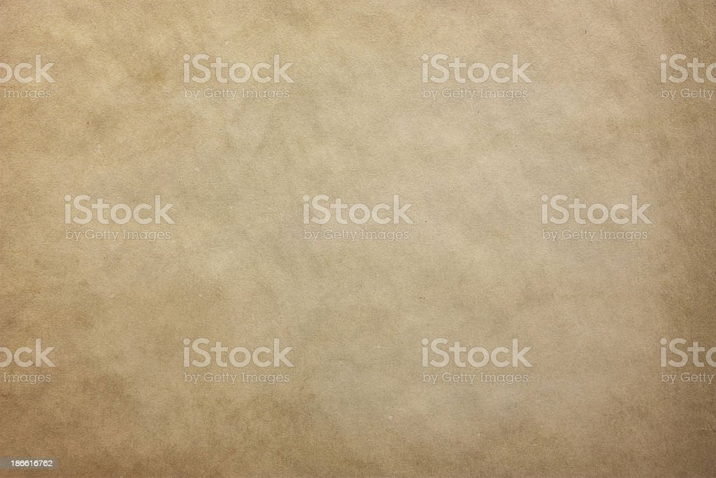 An old and worn out piece of texturized paper  stock photo