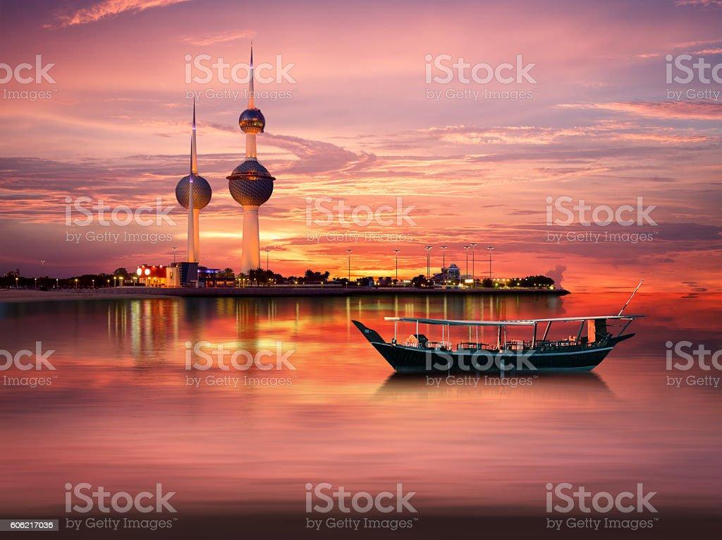 An old Arabian boat docked in front of Kuwait Landmark stock photo