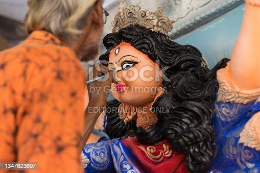 istock An old artist painting eye of Durga idol 1347623697
