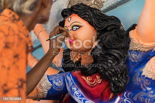 istock An old artist painting eye of Durga idol 1347624454
