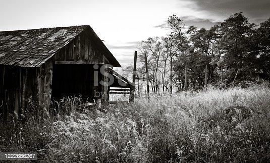 A dramatic photo of a rustic farm