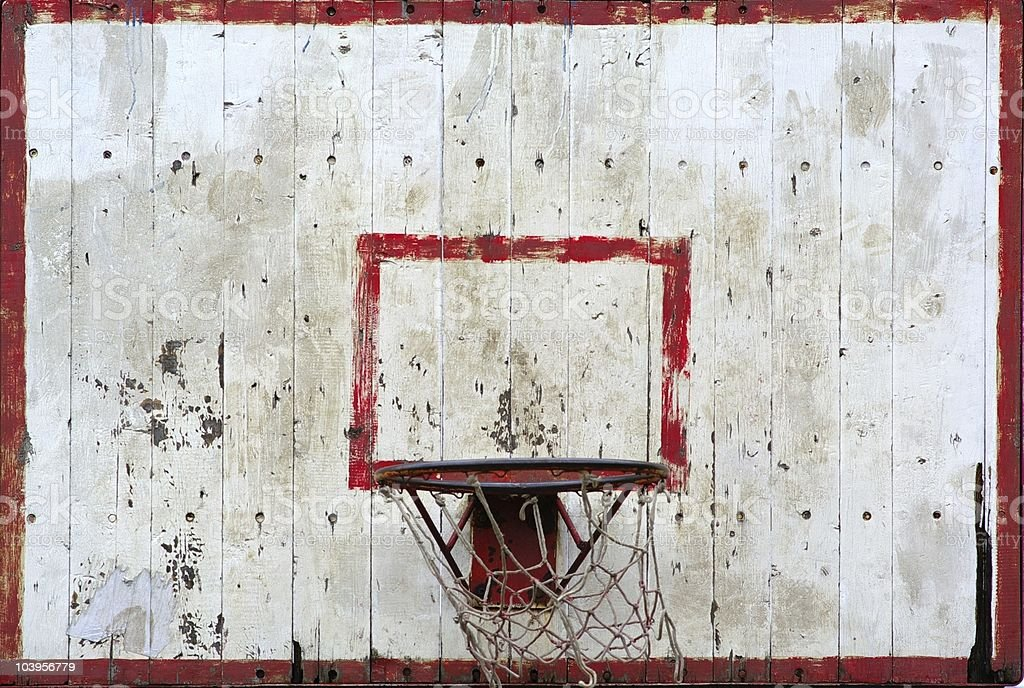 An old basketball back board in red and white stock photo