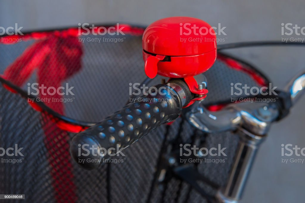 An old bicycle with a beautiful red bell стоковое фото