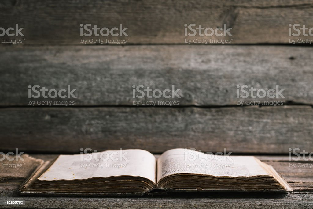 An old book on an old wooden background stock photo
